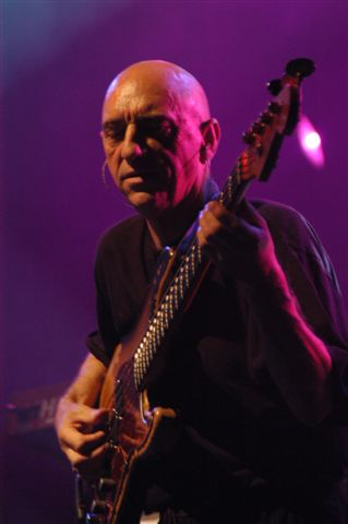 picture of David Bell playing one of his bass guitars